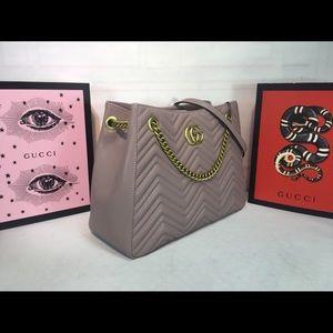 A tan  authentic Gucci bag